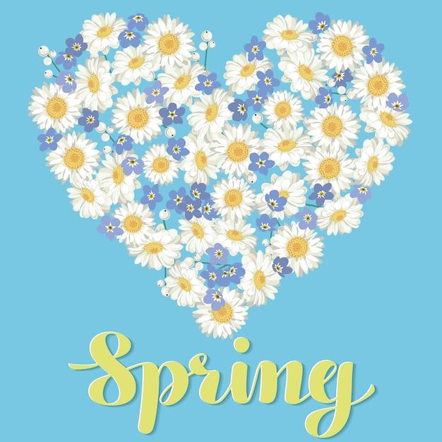 ハート形。青色の背景にカモミールとワスレナグサの花。 Premiumベクター