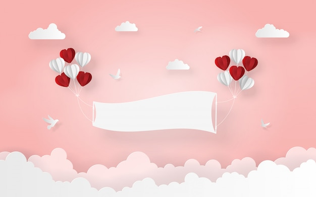 Heart shaped balloon with blank label on the sky Premium Vector