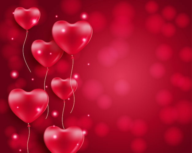Heart shaped balloons on blurred background Premium Vector