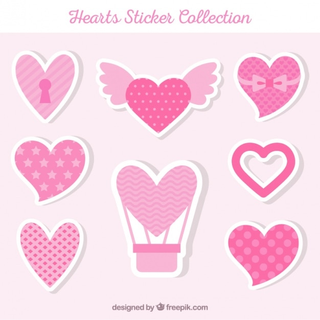 Heart stickers collection in pink tones free vector