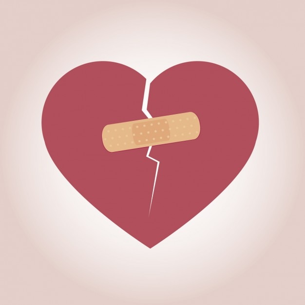 Heart with band-aid Free Vector