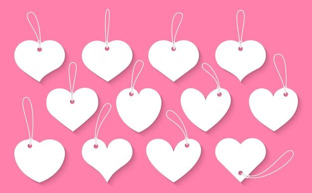 Набор сердец вырезать старинные этикетки. знак дня святого валентина, ценники пустой шаблон для текстового поля различной формы с тенью Premium векторы