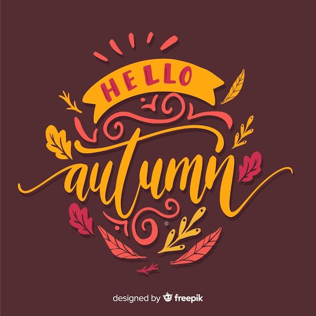 Hello autumn background calligraphic style Free Vector