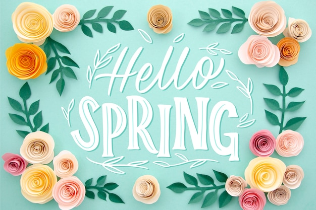 Hello spring lettering with floral frame Free Vector