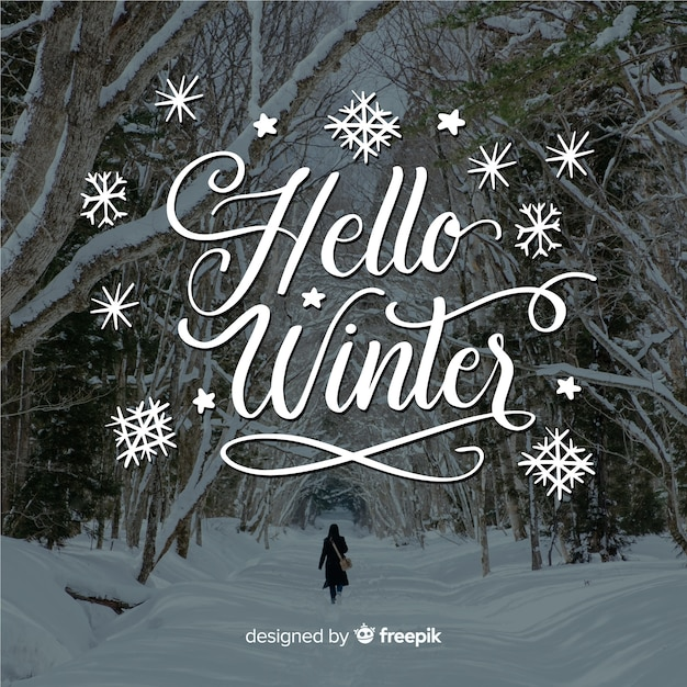 Hello winter lettering with forest and snow Free Vector