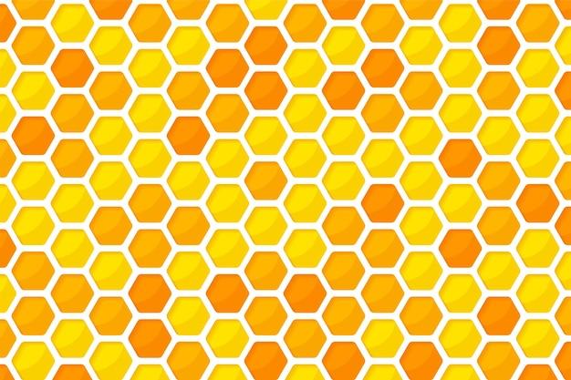 六角形の黄金色のハニカムパターンの紙は、中に甘い蜂蜜と背景をカットしました。 Premiumベクター
