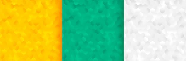 육각형 패턴 배경 세 가지 색상으로 설정 무료 벡터