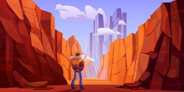 Турист человек с картой на пустынной дороге в каньоне Бесплатные векторы