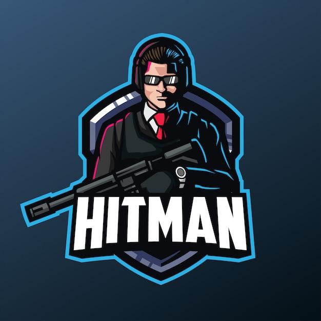 暗い背景に分離されたスポーツとeスポーツのロゴのヒットマンマスコット Premiumベクター