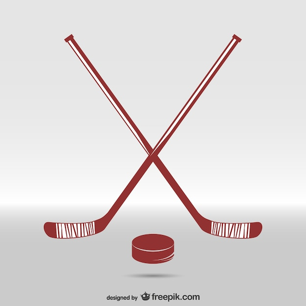 Hockey sticks and puck Free Vector