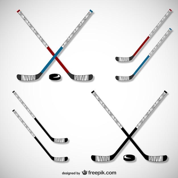 Hockey sticks and pucks set Free Vector