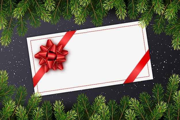 Holiday gift card with red bow, christmas fir tree branches Premium Vector