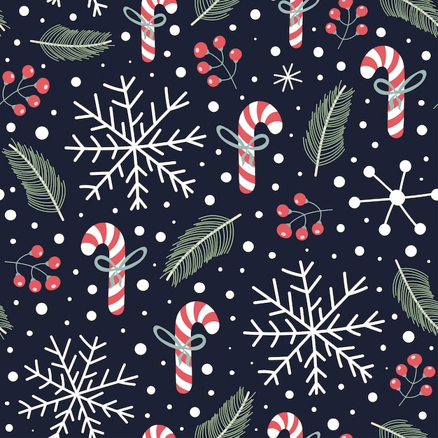 Holiday seamless pattern with christmas candies, snoflakes, fir branches and berries. Premium Vector