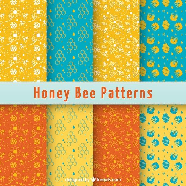 Ручной обращается узоры honney и цветы Бесплатные векторы