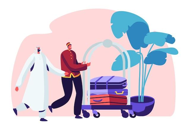 ホテルスタッフのコンセプトイラスト。カートで荷物を運ぶホールでアラビアのゲストに会うホテルスタッフ。 Premiumベクター