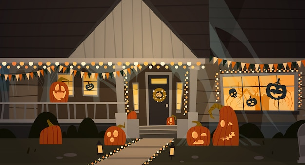 House decorated for halloween, front view with different pumpkins Premium Vector