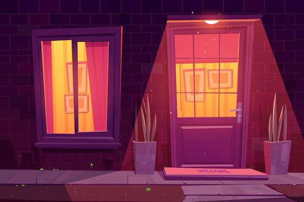 Фасад дома с кирпичной стеной, белыми окнами и дверью, растениями и внешним светильником. Бесплатные векторы