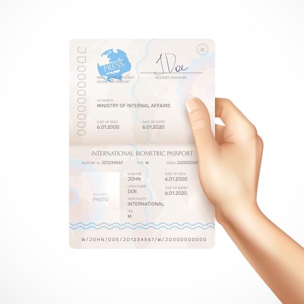 Mano umana che tiene il modello del passaporto biometrico internazionale con data di rilascio e scadenza titolari firma e nome dell'autorità che rilascia passaporto realistico Vettore gratuito