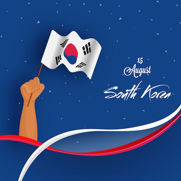 Human hand holding national flag of south korea background Premium Vector