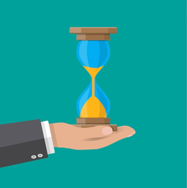 Human hand holds old style hourglass clocks Premium Vector
