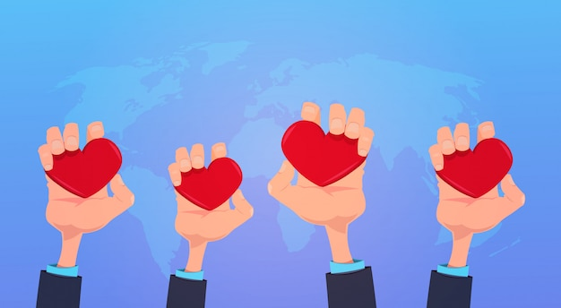 Human hands holding red love heart health care concept on blue world map background flat Premium Vector