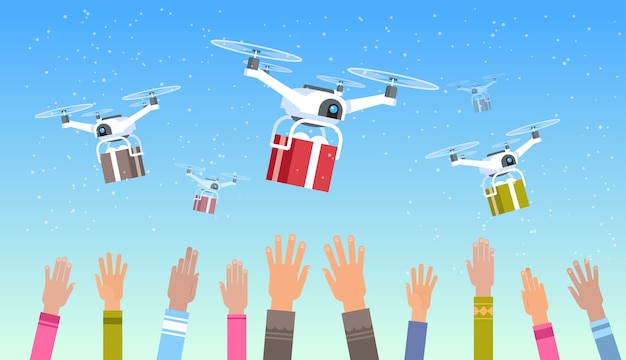 人間の手がドローンを上げてギフトプレゼントボックスを配達空の輸送輸送航空便速達の概念 Premiumベクター