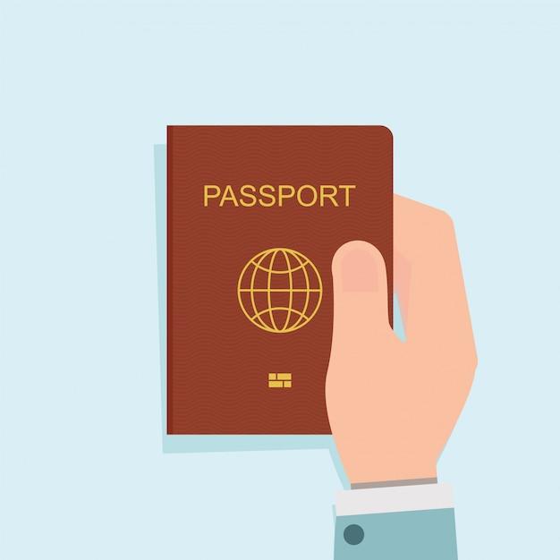 Human holding red passport. Premium Vector