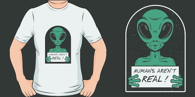 人間は本物ではありません。ユニークでトレンディなエイリアンtシャツデザイン Premiumベクター