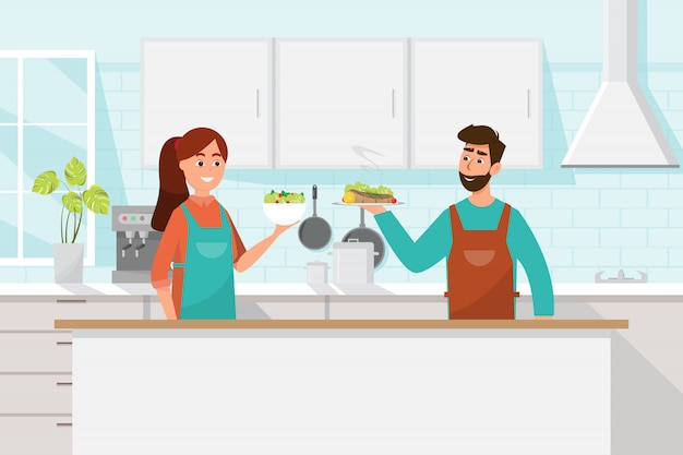 Husband and wife cooking together. man and woman in the kitchen Premium Vector