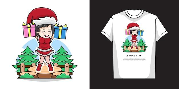 サンタクロースの衣装を着て、tシャツのデザインでクリスマスプレゼントを保持しているかわいい女の子のイラスト Premiumベクター