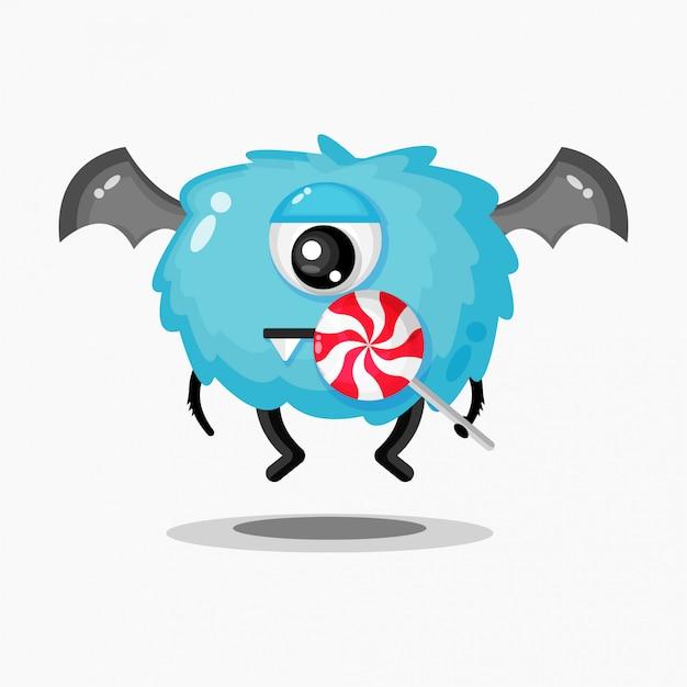 막대 사탕을 먹는 귀여운 괴물의 그림 프리미엄 벡터