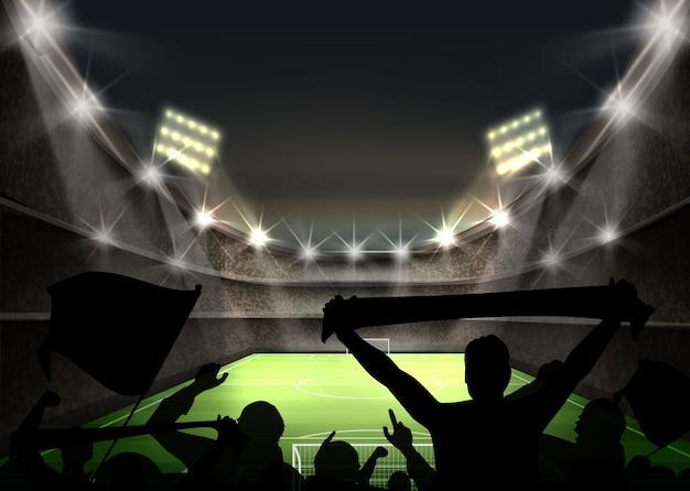 밝은 스포트 라이트와 경기장의 그림은 녹색 축구장과 팬 실루엣을 조명 무료 벡터