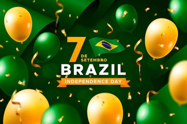 Giorno dell'indipendenza del brasile con palloncini e bandiere Vettore gratuito