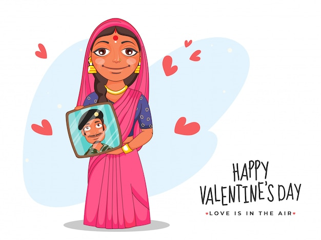 Indian woman showing her husband photo frame with red hearts on the occasion of happy valentine's day, love is in the air . Premium Vector