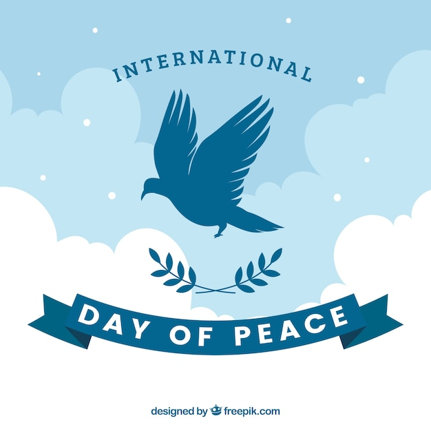International peace day background with dove silhouette