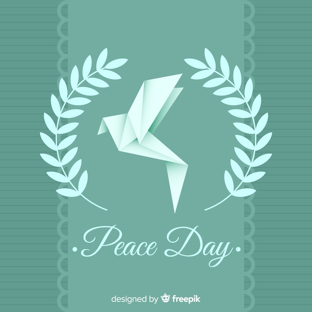 International peace day with origami dove Free Vector