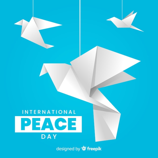 International peace day with origami doves Free Vector
