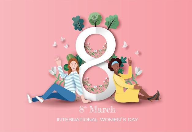 Международный женский день, две счастливые женщины, сидящие с фоном цветов в бумажной иллюстрации. Premium векторы