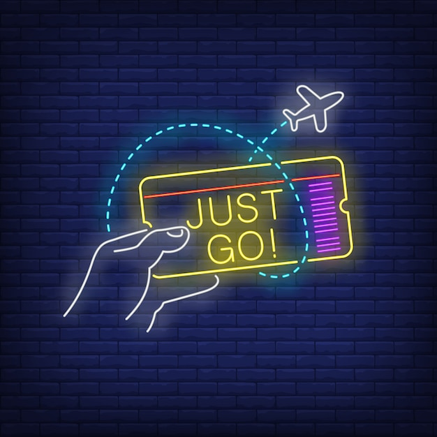 Just go neon lettering and hand holding flight ticket Free Vector
