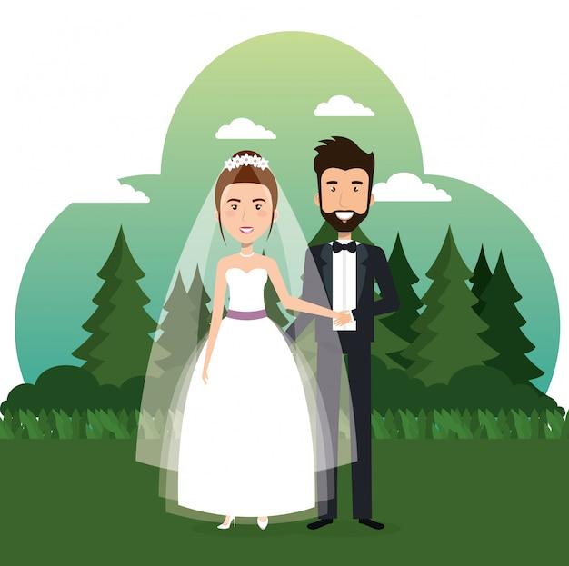 Coppia appena sposata nel campo Vettore gratuito