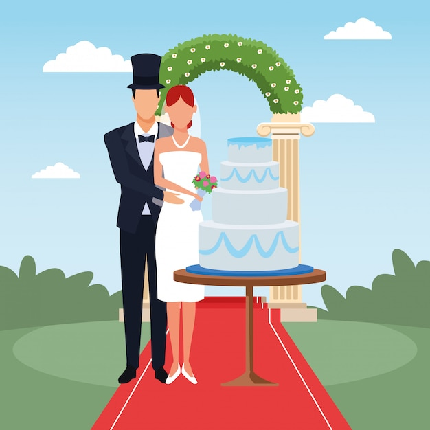 Just married couple standing with wedding cake and floral arch around Premium Vector