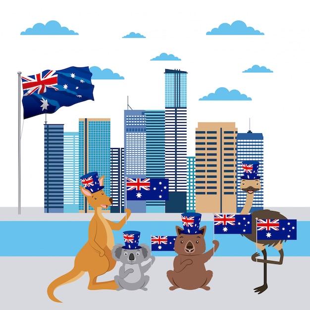 Кенгуру, коала, страус и австралийские животные с флагом Бесплатные векторы