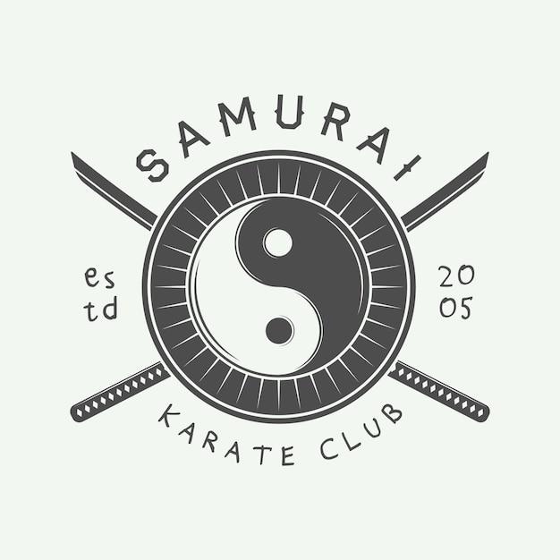 Karate or martial arts logo Premium Vector