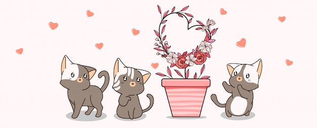 Kawaii cats are taking care of heart-shaped plant Premium Vector