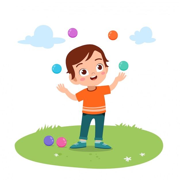 Kid boy juggling balls Premium Vector