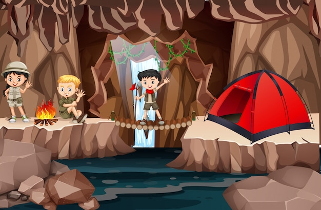 Kid scouts exploring cave Free Vector