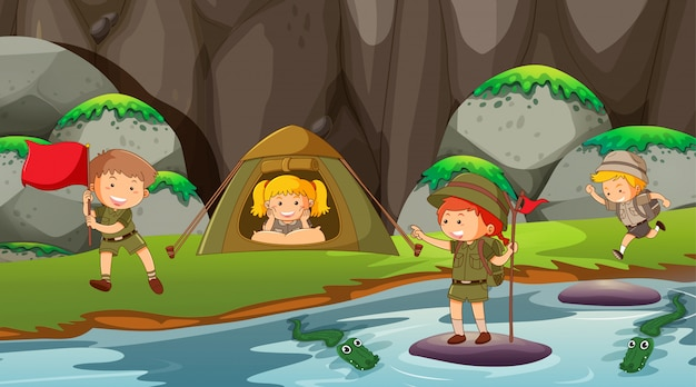 Kids camping outdoors scene or background Free Vector