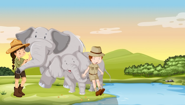 Kids and elephants by the river Free Vector