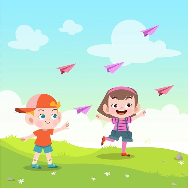 Kids play paper plane in the park vector illustration Premium Vector