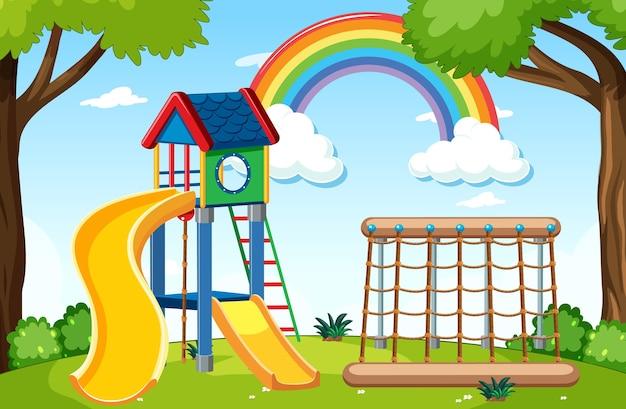 昼間の漫画のスタイルで空に虹と公園の子供の遊び場 Premiumベクター